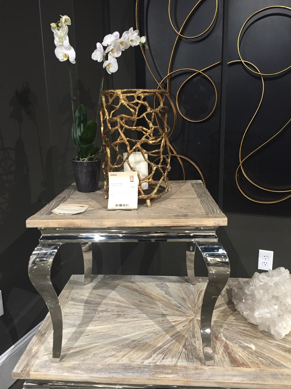 I loved the juxtaposition of the shiny metal and bleached wood in this table offered by Uttermost